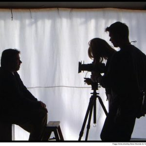 At a photo shoot, Peggy Sirota at Camera